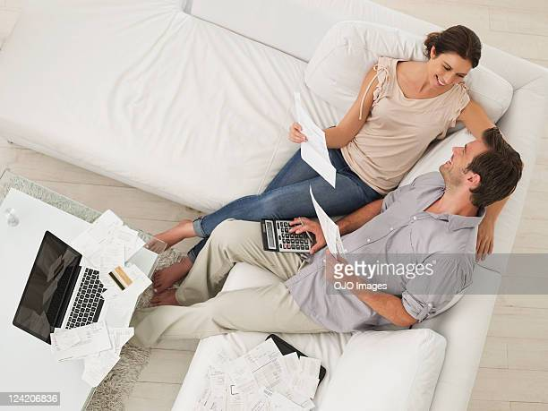 High angle view of a mid adult couple working on home finance together