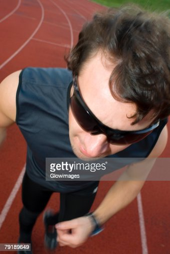 High angle view of a mid adult man running on a running track : Foto de stock