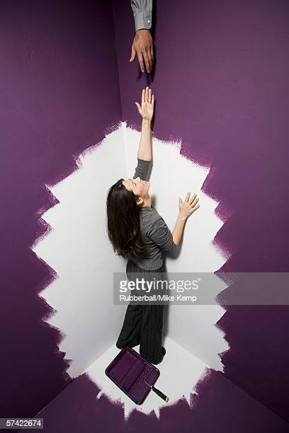 High angle view of a mid adult woman reaching out for a man's hand
