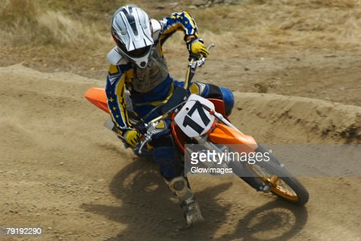 High angle view of a motocross rider riding a motorcycle : Stock Photo