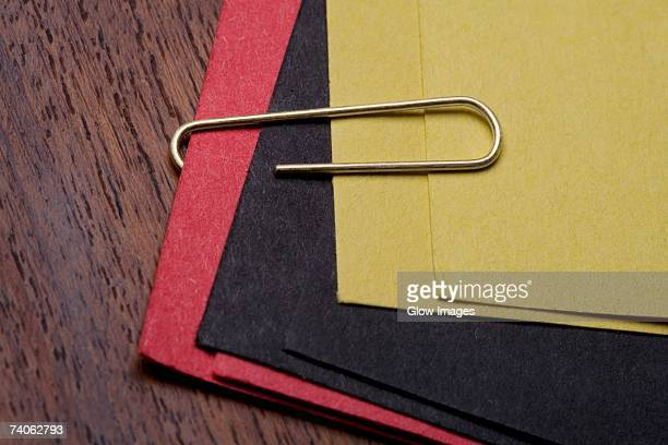 High angle view of a paper clip on files