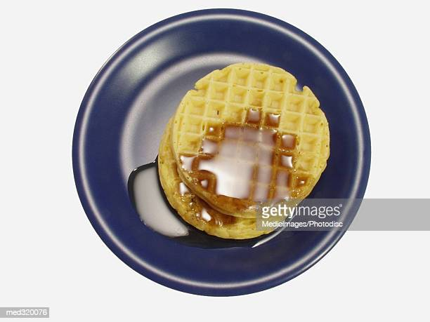 High angle view of a plate of pancakes with maple syrup