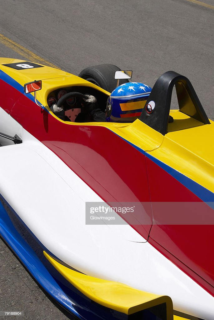 High angle view of a racecar driver in a racecar : Stock Photo