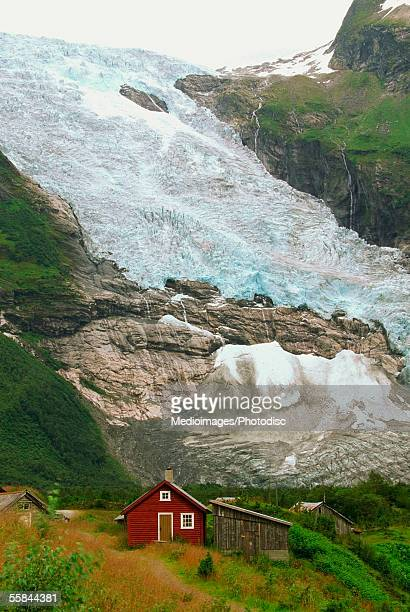 High angle view of a red house near a glacier, Jostedalsbreen Glacier, Voss, Hordaland, Norway