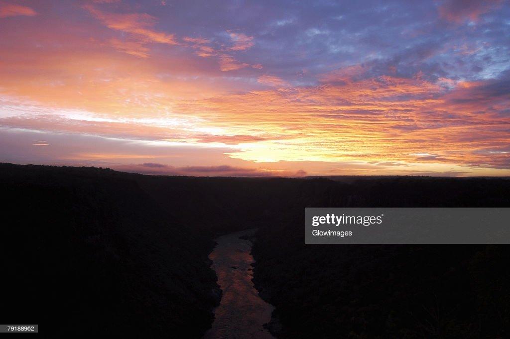 High angle view of a river passing through mountains at sunset, Zambezi River, Zimbabwe : Stock Photo