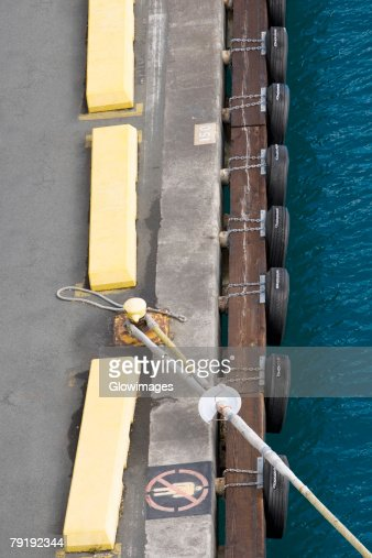 High angle view of a rope tied up with a bollard : Foto de stock