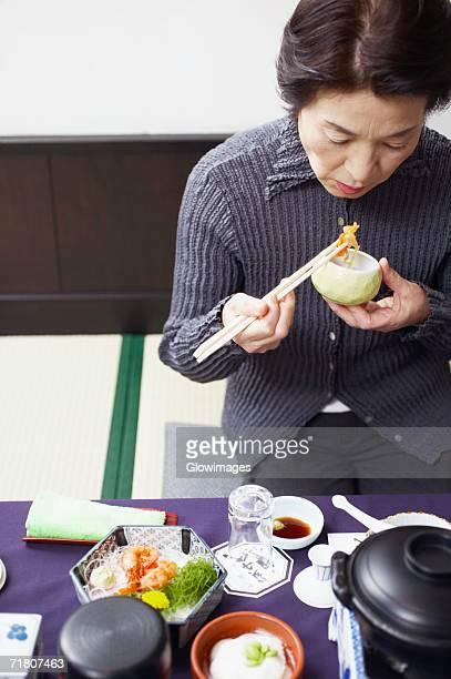 High angle view of a senior woman eating