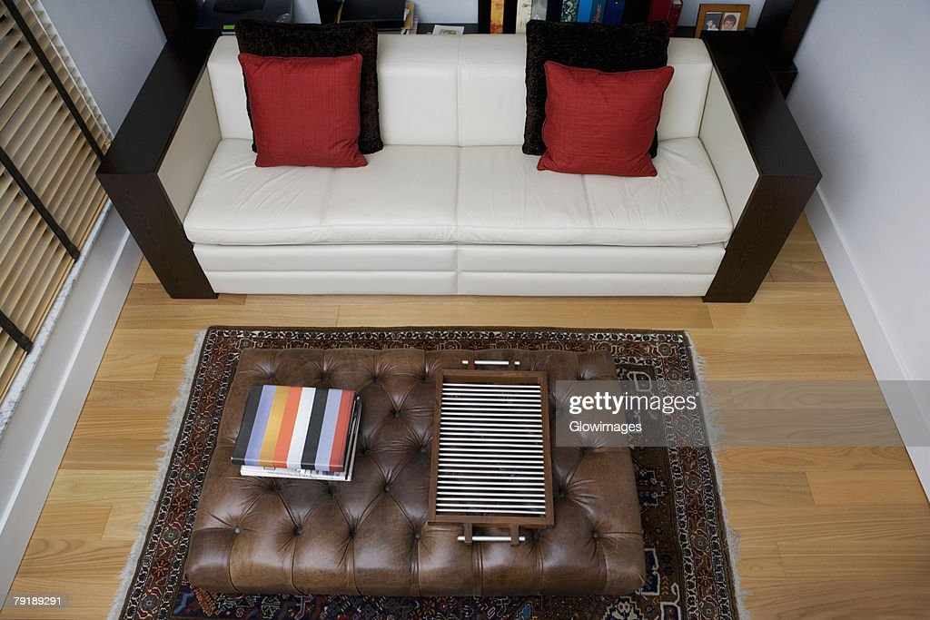 High angle view of a serving tray and towels on a table in a living room : Stock Photo