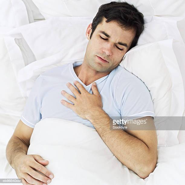 high angle view of a sick young man in a hospital bed