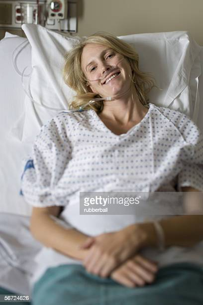 High angle view of a smiling female patient in bed