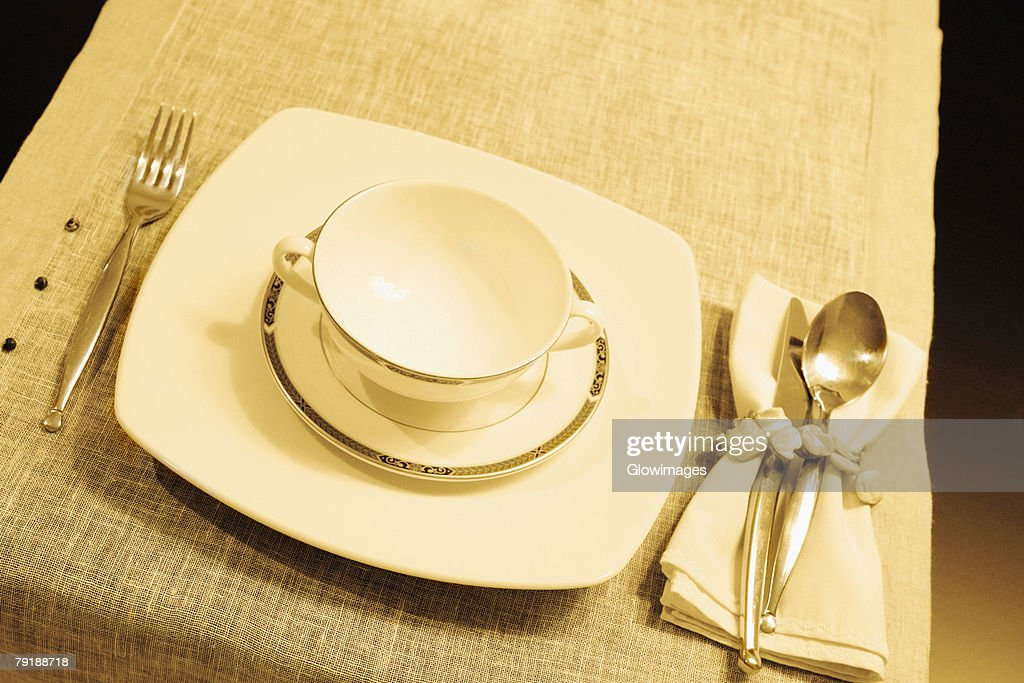 High angle view of a soup bowl with a plate on a dining table : Foto de stock