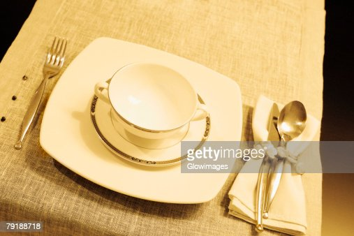 High angle view of a soup bowl with a plate on a dining table : Stock Photo