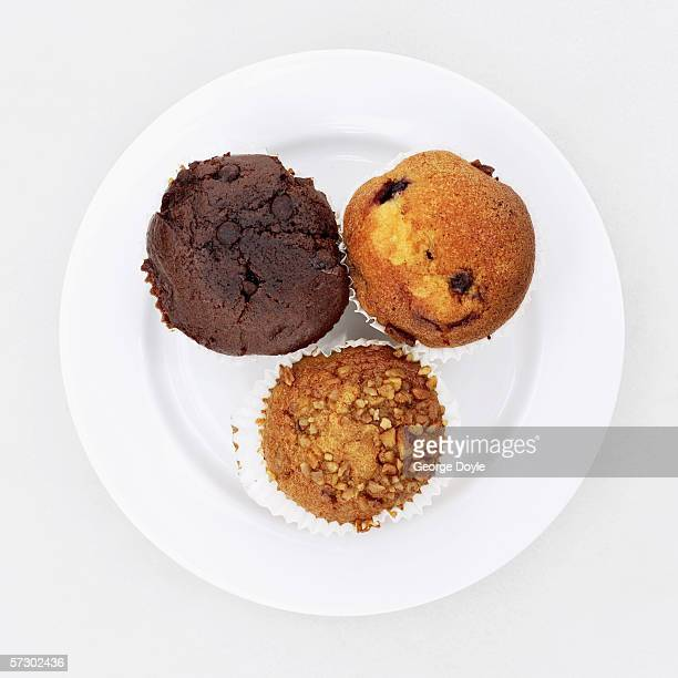 High angle view of a three assorted cupcakes on plate
