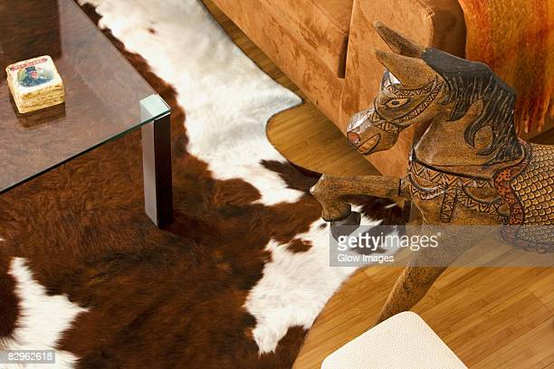 High angle view of a wooden horse near a couch