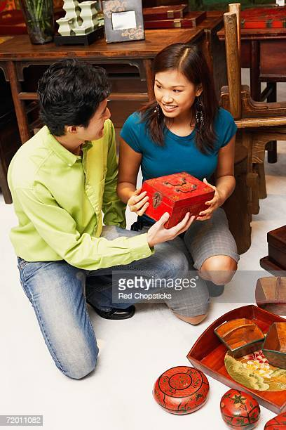 High angle view of a young couple choosing merchandise in a store