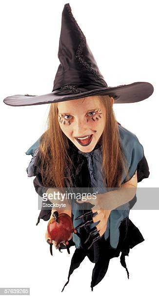 high angle view of a young girl in a witches costume