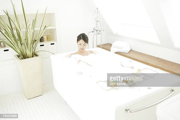 High angle view of a young woman relaxing in a bubble bath