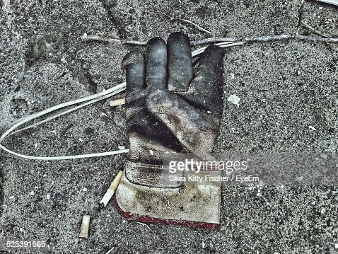 High Angle View of Abandoned Glove On Footpath