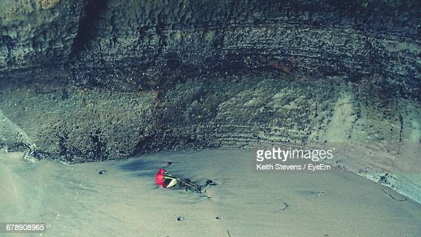 High Angle View Of Abandoned Red Rose At Beach