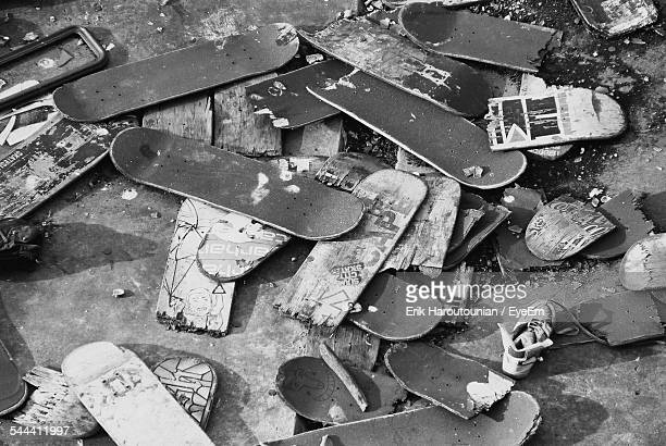 High Angle View Of Abandoned Skateboards At Junkyard