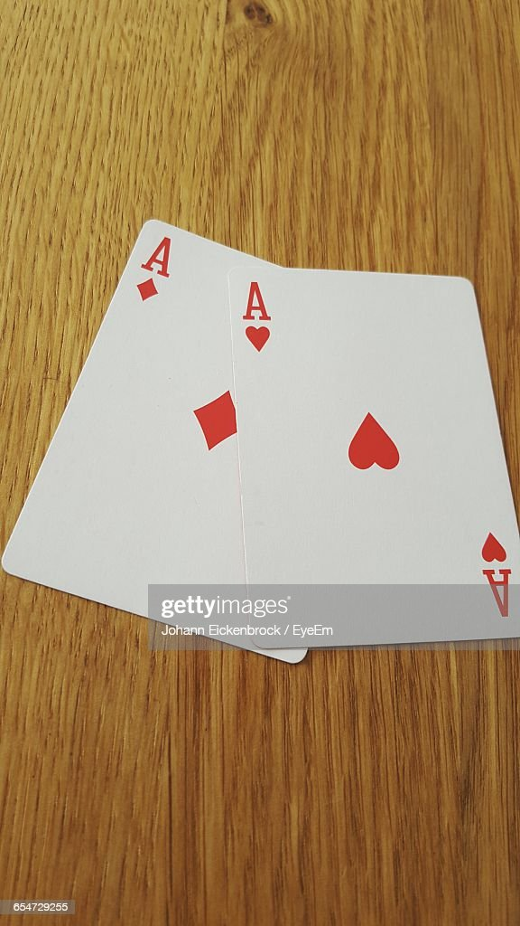 High Angle View Of Aces On Table