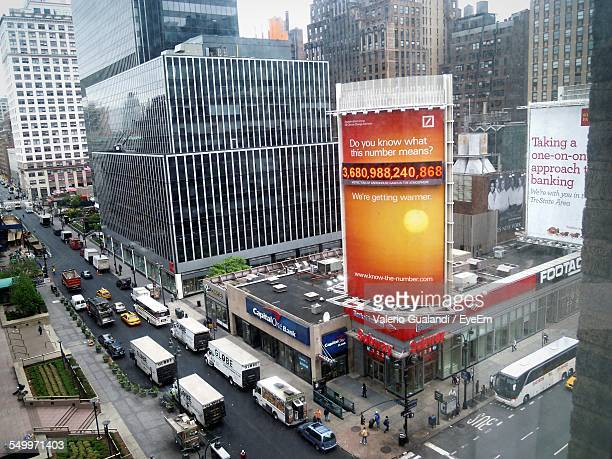 High Angle View Of Advertisements On Building Above Street