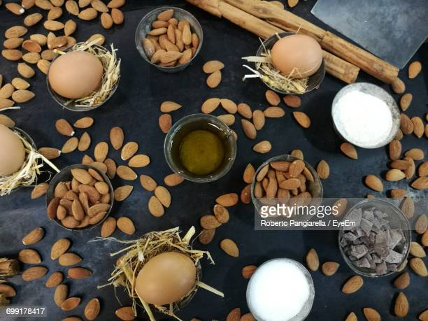 High Angle View Of Almonds With Eggs In Containers On Table