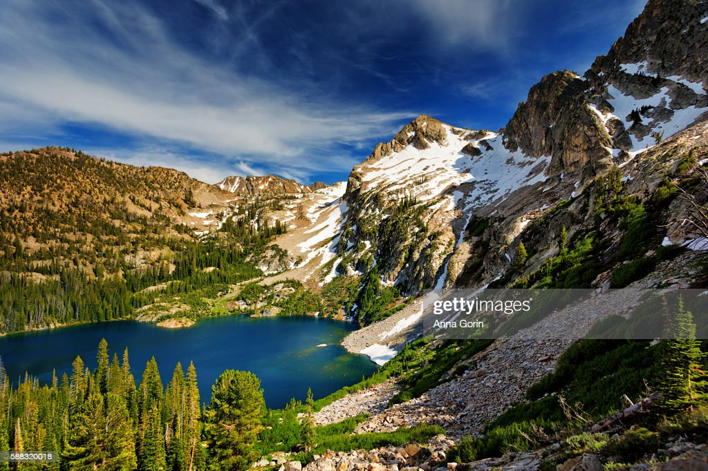 High angle view of Alpine Lake surrounded with early summer snow, Stanley, Idaho
