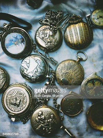 High Angle View Of Antique Pocket Watches