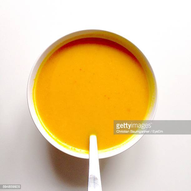 High Angle View Of Apple Ginger Soup Served In Bowl On Table