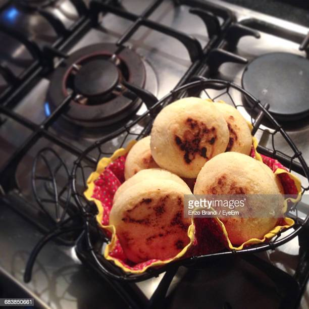 High Angle View Of Arepas In Container On Stove