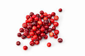 Fruit: Close up of Fresh and ripe cranberry fruits on white