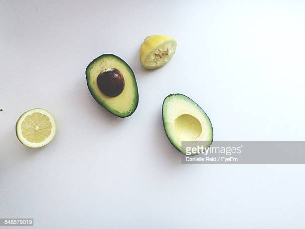 High Angle View Of Avocados And Lemons Against White Background