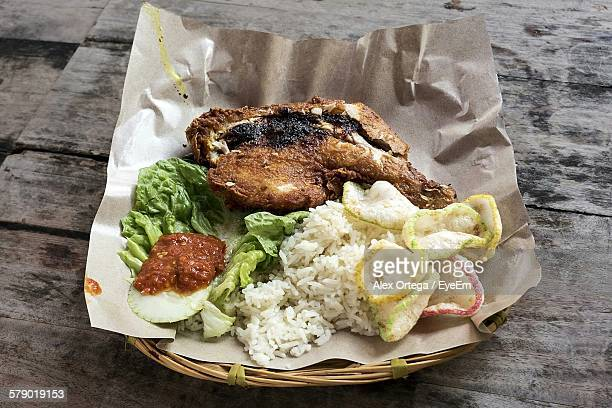 High Angle View Of Ayam Penyet Served In Basket