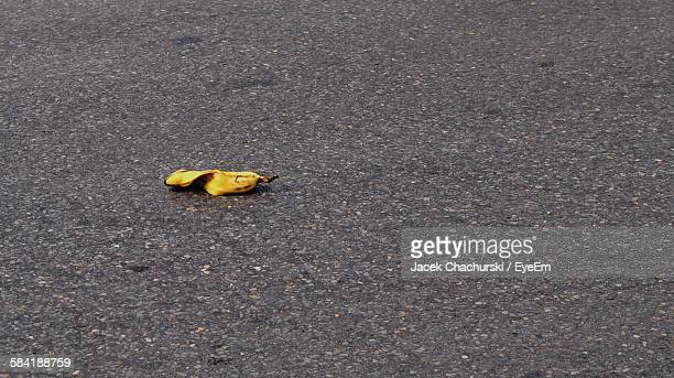 High Angle View Of Banana Peel On Street
