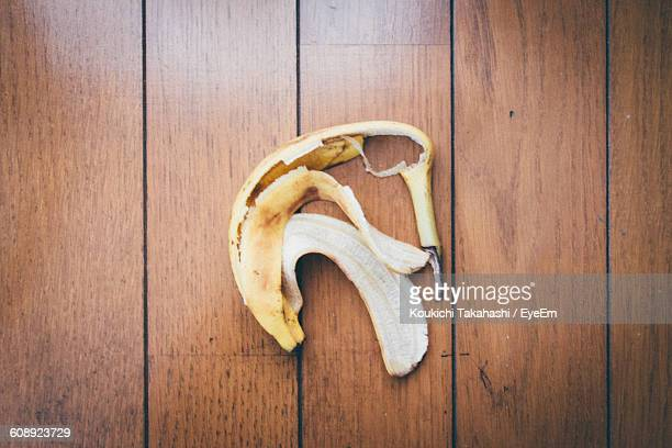 High Angle View Of Banana Peel On Wooden Table