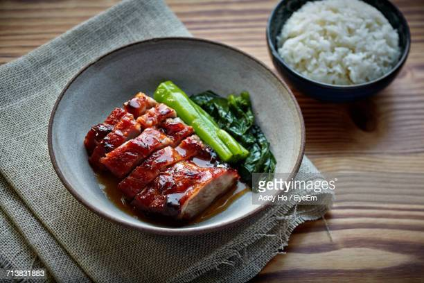 High Angle View Of Barbecue Pork With Rice In Bowl On Table