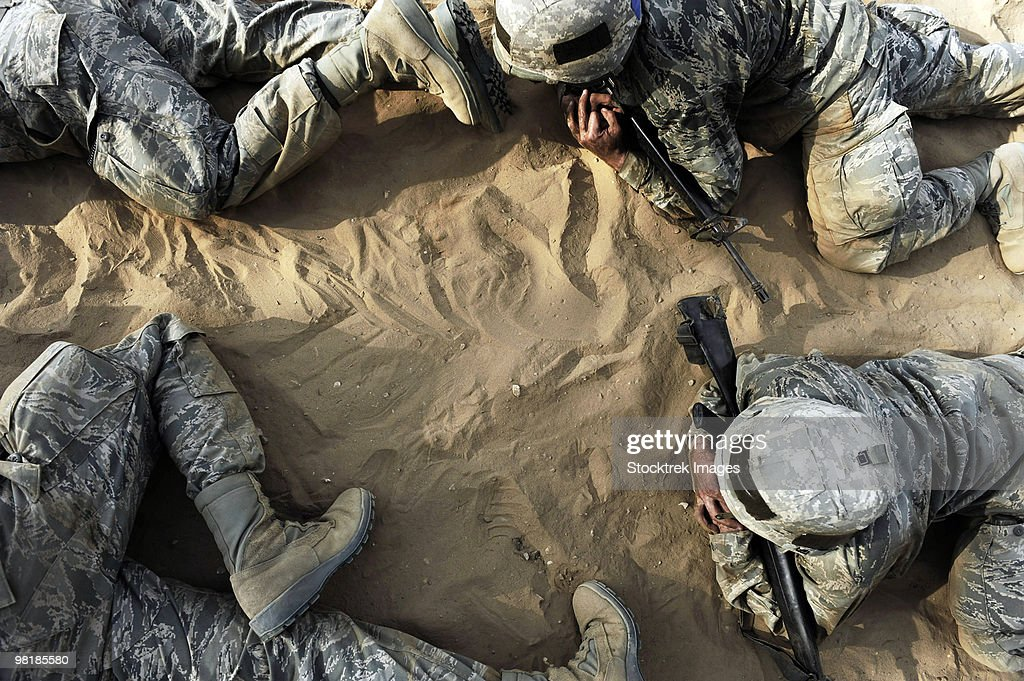 High angle view of Basic trainees crawling through a tactical course.