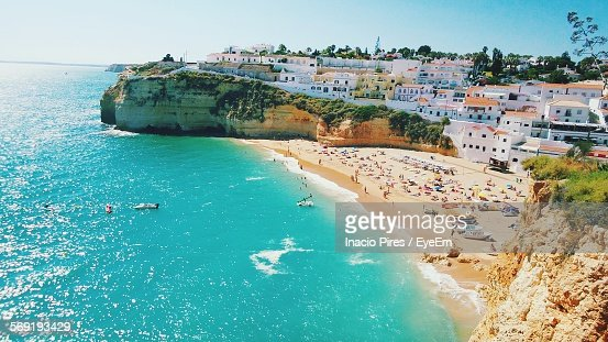 High angle view of beach and houses at Carvoeiro against clear sky