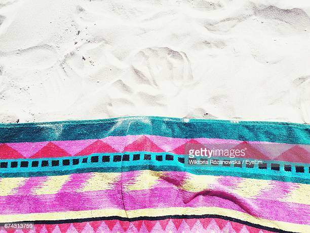 High Angle View Of Beach Towel On Sand