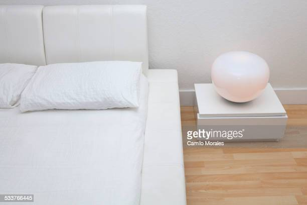 High angle view of bed and night table in modern bedroom