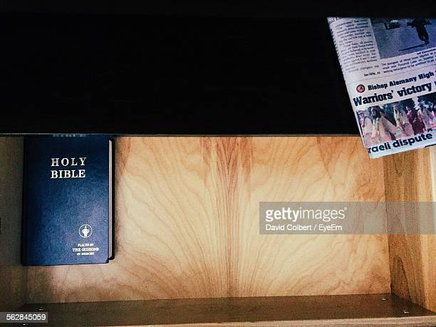High Angle View Of Bible Book In Drawer