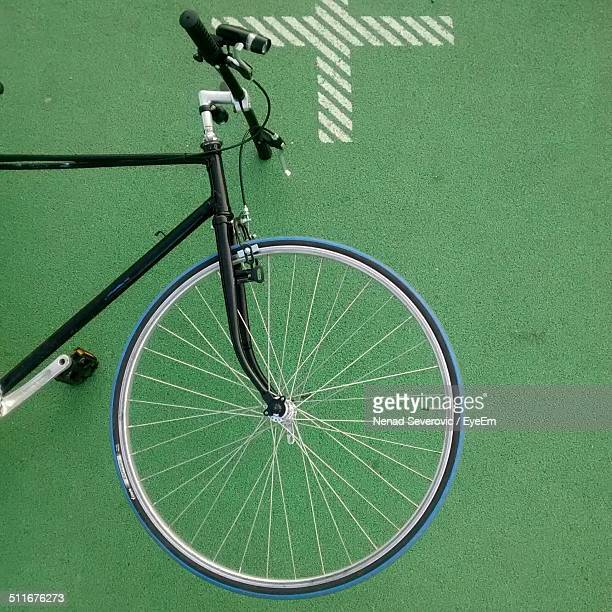 High angle view of bicycle on green surface