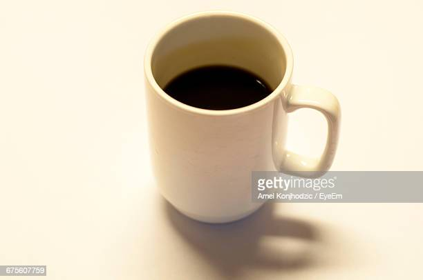 High Angle View Of Black Coffee Cup On Table