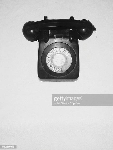 High Angle View Of Black Retro Telephone Over White Background