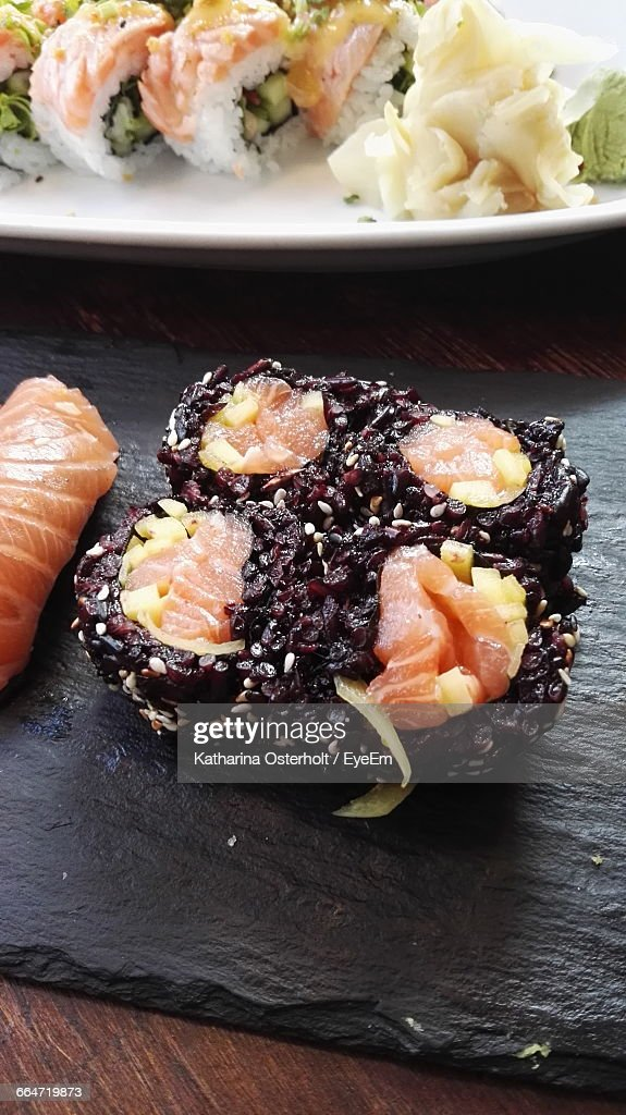 High Angle View Of Black Rice Sushi On Table