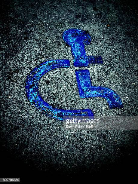 High Angle View Of Blue Disabled Sign On Street