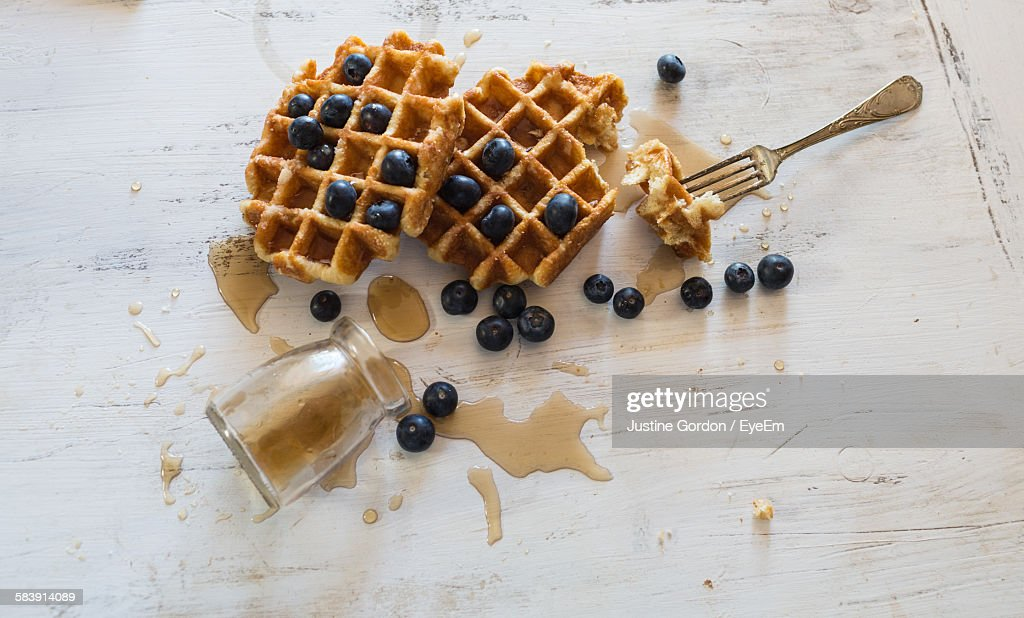 High Angle View Of Blueberries With Waffle On Table : Photo
