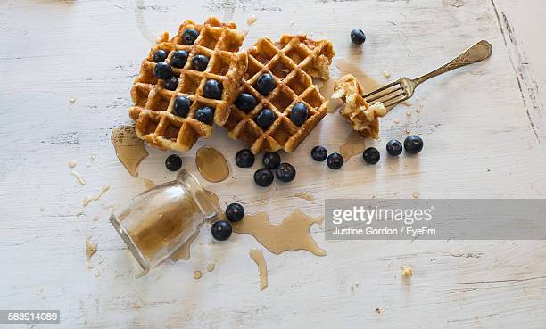 High Angle View Of Blueberries With Waffle On Table