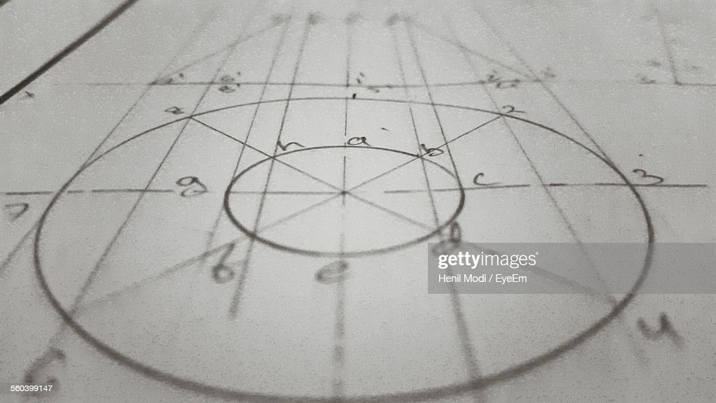 High Angle View Of Blueprint On Paper